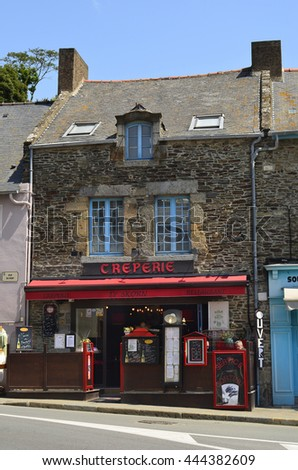 CANCALE, FRANCE - JUNE 10: Unidentified people outside a restaurant and creperie in the village in Brittany, on June 10, 2011 in Cancale, France