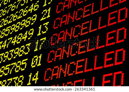 Cancelled flights on airport board panel - stock photo