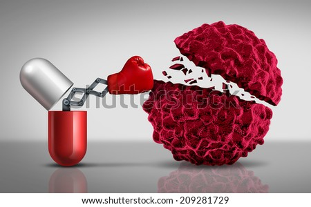 Cancer drugs fighting a cancerous cell as a health care medical concept for a pharmaceutical cure to fight the dangerous disease with life saving medication. - stock photo
