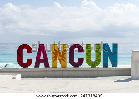 CANCUN - JANUARY 20: CANCUN inscription in front of the Playa Delfines beach on 20 January 2015 in Cancun, Mexico. This is one of the best beaches in the Mexico. - stock photo