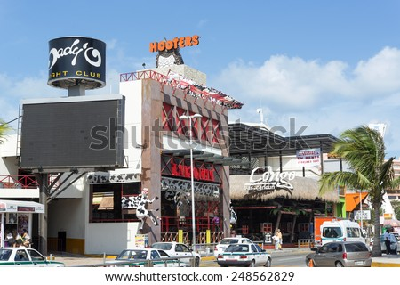CANCUN - JANUARY 22: The main street of the hotel zone close to the beach on 22 January 2015 in Cancun, Mexico. In this street is a lot of stores and restaurants for tourists from all over the world.