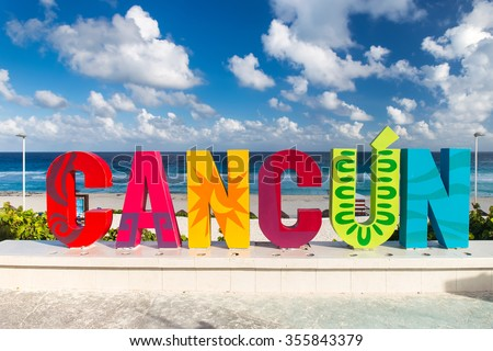Cancun, Mexico - 12 December 2015: CANCUN inscription in front of the Playa Delfines beach - stock photo