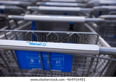 Cancun, Mexico - 9 February 2016: Shopping cart near Walmart supermarket. Closeup on shop trolley with sign Walmart