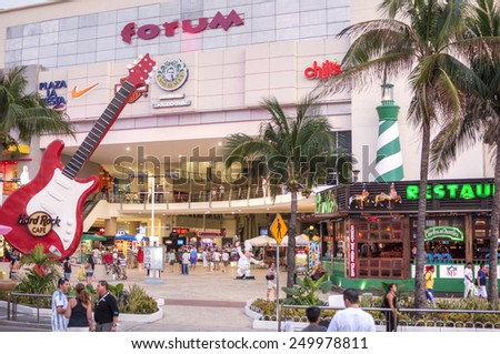 CANCUN, MEXICO - JANUARY 22, 2015: The Forum in the Cancun hotel zone is a popular place for tourists to enjoy modern shopping, restaurants, bars, nightclubs, and people watching - stock photo
