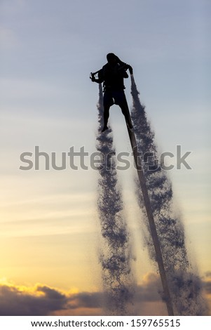 Water powered jetpack in cancun mexico on oct 16 2013 stock photo