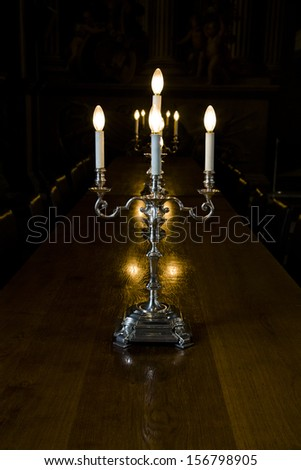candelabra on wooden table - stock photo