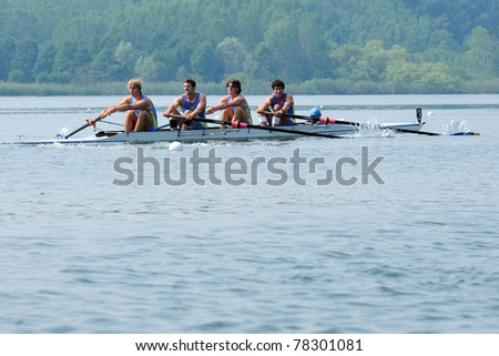 CANDIA, TURIN, ITALY - MAY 22: the CUS Pavia coxed four (4+) crew rowing during 2011 Rowing CNU University National Championship on May 22, 2011 on Candia lake, Turin, Italy - stock photo