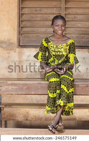 Candid African Shot: Huge Positive Smile on Black School Girl  - stock photo