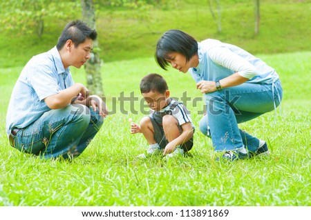 Candid Asian family at outdoors