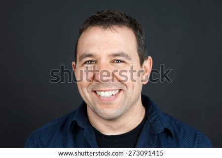 Candid portrait of friendly smiling man, natural concept - stock photo