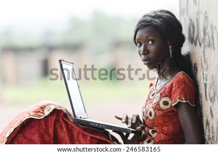 Candid Shot African Girl Learning Her Lesson With Computer - stock photo