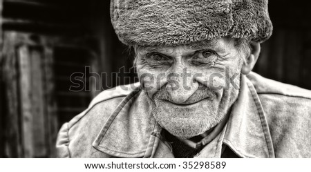Candid smile of adorable wise senior man - stock photo