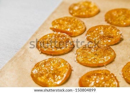 Candied Orange/Clementine Slices on Parchment Paper - stock photo