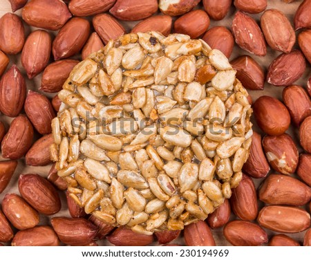 Candied roasted peanuts sunflower seeds. Isolated on a white background.