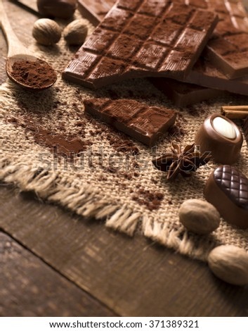 Candies Chocolate vintage style. Delicious assortment of chocolates - stock photo