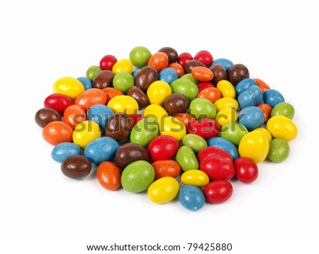 Candies - glazed chocolate peanuts - stock photo