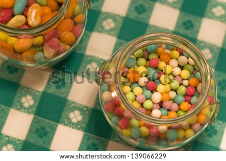 Candies in cliche candy jar - stock photo