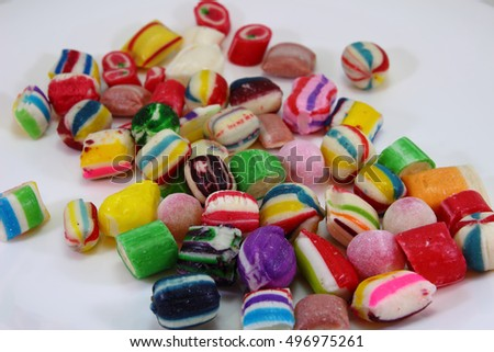 candies in different colors on a white background