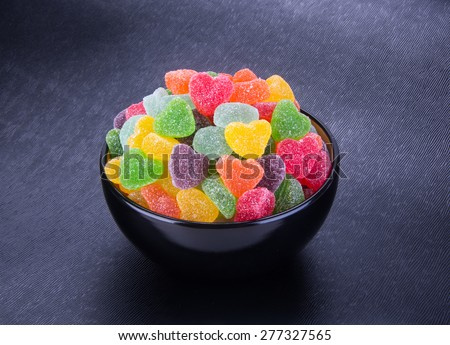 candies. jelly candies in bowl on a background. jelly candies in bowl on a background. - stock photo