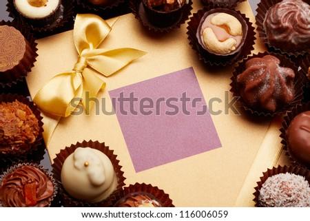 Candies near a festive card - stock photo