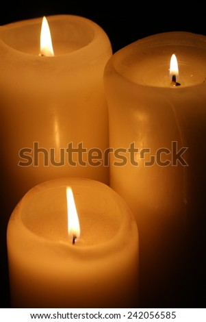 Candle and candlelight in the dark - stock photo
