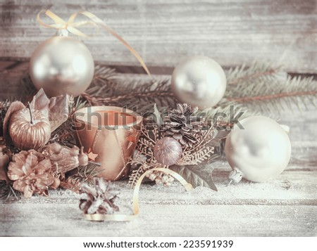 Candle  and Chrismas decorations over wooden background  - stock photo