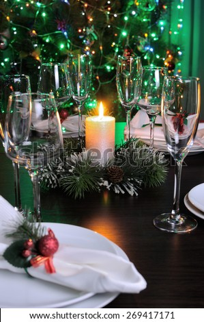 Candle and cones as an element of decor Christmas table