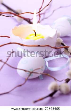 candle and easter egg for easter decoration - stock photo