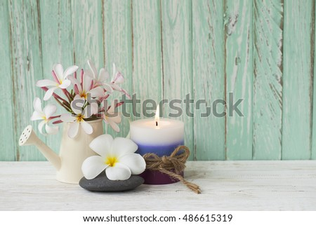 Candle and flower on wood background, concept for    Specail itme.