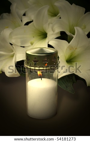 Candle and flowers for condolences - stock photo