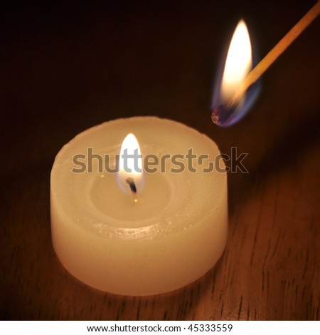 Candle and match - stock photo