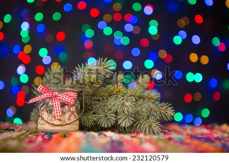 Candle and spruce on Christmas lights background, perfect for Xmas card