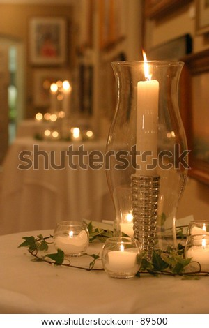 Candle at a  wedding reception. - stock photo