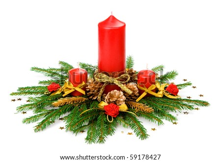 Candle balls and ribbon in spruce branches - stock photo