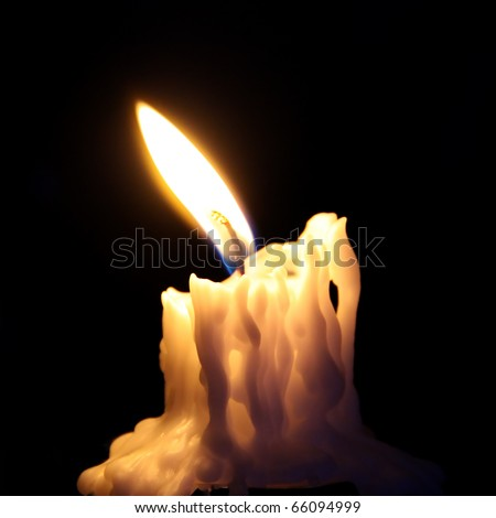 Candle burning in the dark - stock photo