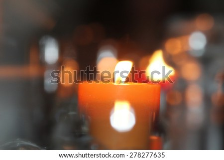 Candle defocused lighting equipment illuminated selective focus  - stock photo