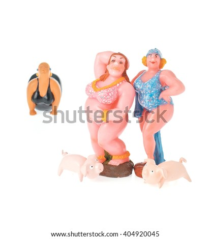 candle doll and pigs doll - stock photo