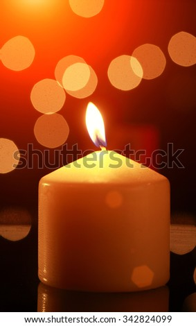 Candle flame against abstract background