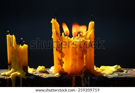 Candle flame closeup isolated on black - stock photo