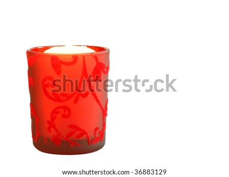 Candle in a beautiful red candlestick isolated on white
