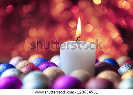 Candle in a christmas decoration - stock photo