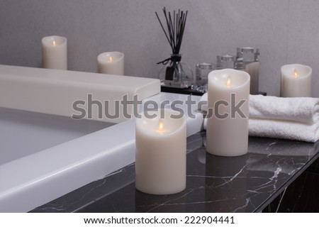 candle in bathroom on the bath tub