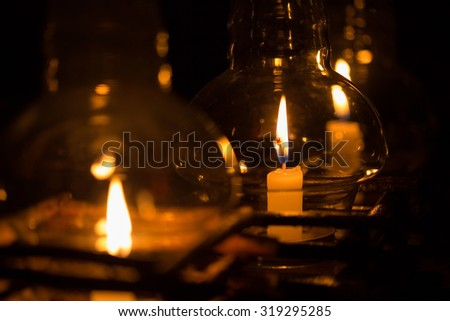 candle in glass lantern at the night  - stock photo