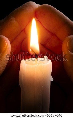 Candle in hands - stock photo