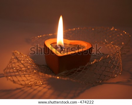 candle in shape of heart - stock photo