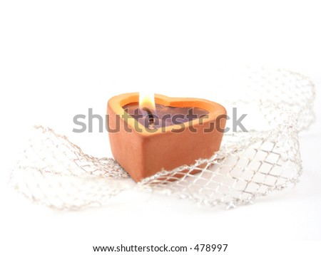 candle in shape of heart (high-key photo) - stock photo