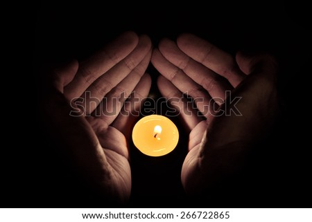 Candle in the hand, Hope and pray concept - stock photo