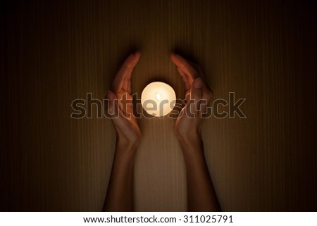 Candle in the hands - stock photo