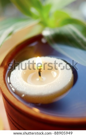 candle in water - stock photo
