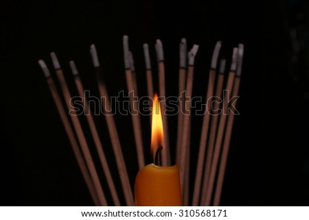 candle, incense stick - stock photo
